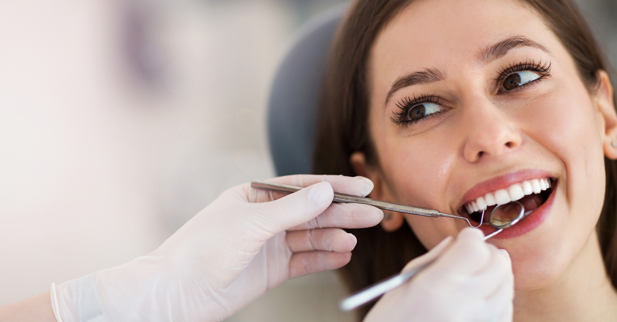 Image of a dental patient getting a checkup for the crowns and bridges page